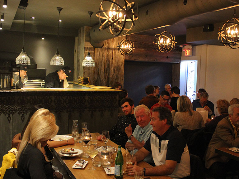 About Brick N Fire. We have renovated and built out a brand new private dining area at Brick N Fire. Our private room can accommodate up to 40 guests seated and 75 standing for special occasions, business lunches and private parties.